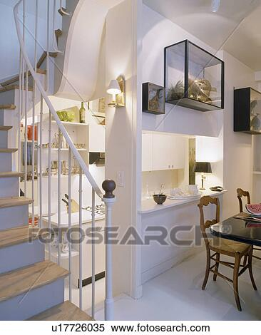 Stock Image Of Compact Modern Understairs Kitchen With Large Hatch