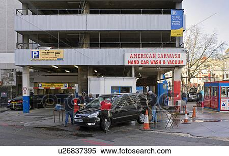 stock image of england london shoreditch american style hand car wash and vacuum outside a. Black Bedroom Furniture Sets. Home Design Ideas