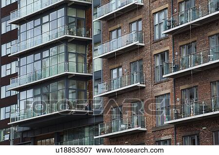 England Greater Manchester Detail Shot Of Modern Apartments Formed By Redevolping Victorian Warehouses Located On The Banks River
