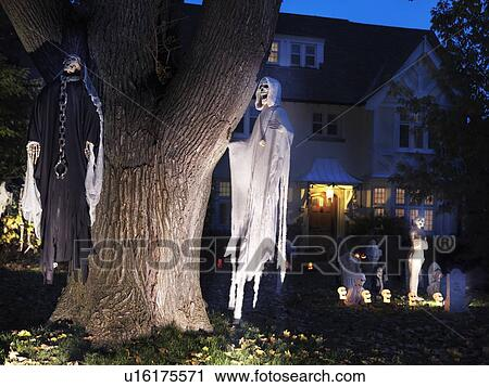 Stock photography of spooky halloween decoration ghosts and cemetery in the front yard of a - Halloween decorations toronto ...