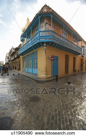 Stock photography of turquoise shutters on a historic for Cobblestone shutters