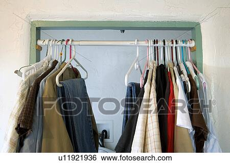Stock Images Of Curtain Rod In Doorway With Hanging Clothes