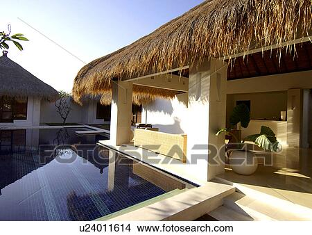 Stock Photo Of Bungalows With Thatched Roofs Near A Swimming Pool
