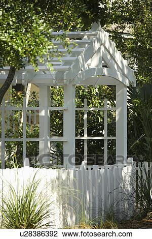 Stock Photo Of Garden Arbor With White Picket Fence