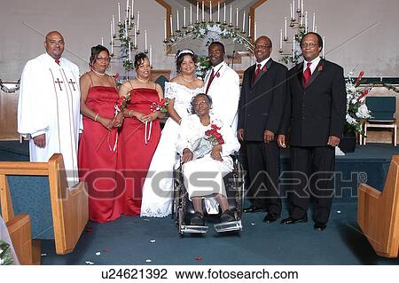 Stock Photo of African American bride and groom posing at a church ...