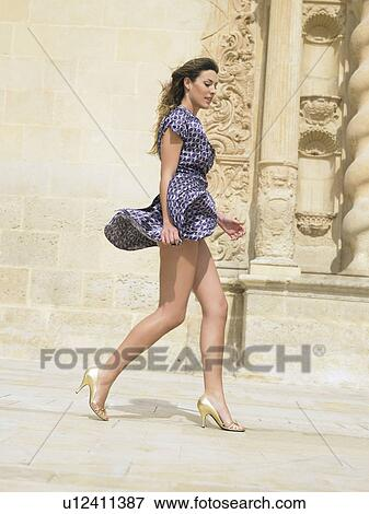 picture of walking with skirt blowing in