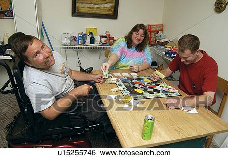 Stock Images of Three friends playing a board game and ...