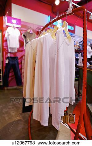 Different kinds of clothes showing in the store,Clothing Store View