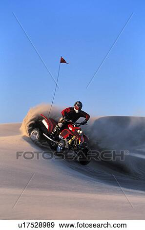 Stock Photograph Of Four Wheeler Descending Sand Dune