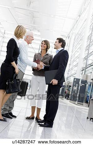 Picture of 4 people greeting each other u14287247 search stock 4 people greeting each other m4hsunfo