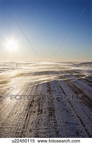 stock image of ice covered road with tire tracks Wind Clip Art Foggy' Clip Art