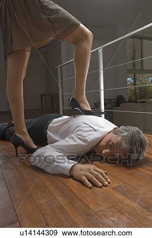 Stock Photograph Of Woman Standing On Dead Man S Body