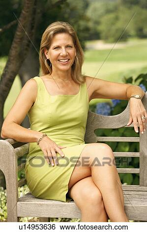 Stock Images Of Portrait Of A Mature Woman Sitting On A