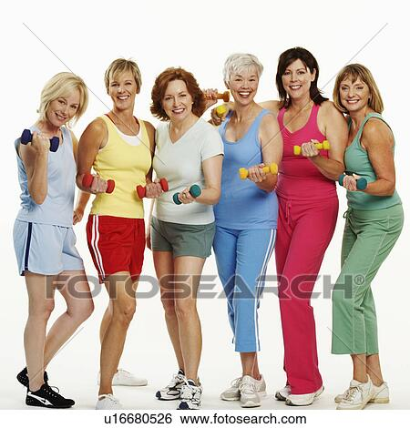 Stock image of portrait of a group of mature women holding dumbbells