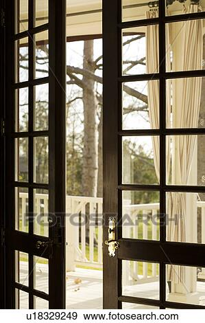 Stock photograph of open french doors to outside u18329249 for French doors that both open