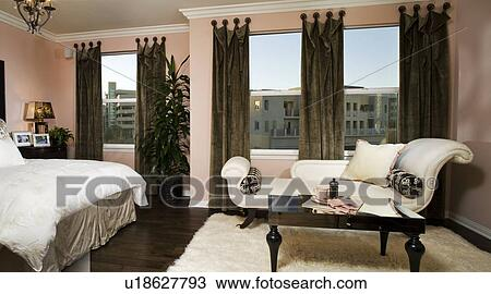 Stock photo of elegant master bedroom with chaise lounge for Chaise and lounge aliso viejo
