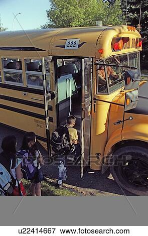 Picture of children loading a school bus u22414667 search stock picture children loading a school bus fotosearch search stock photography photos voltagebd Choice Image