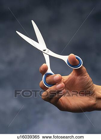 Stock Image of Hand holding scissors, Close Up u16039365 ...