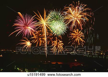 Stock Photograph of Fireworks exploding in sky, long ...