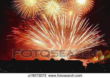 Stock Photo of Fireworks exploding in sky, long exposure ...