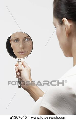 Stock Photo Of Woman Holding Hand Mirror U13676454