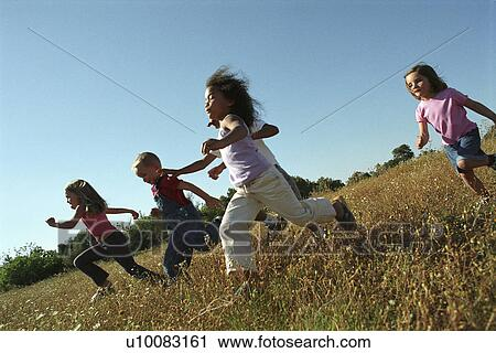 Stock Photography of Five children running in field ...