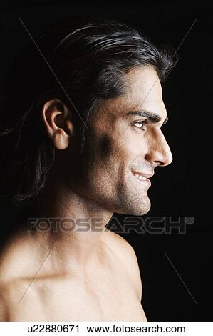 stock photography of side profile of a young man smiling