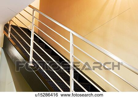 stock images of detail of metal staircase raili