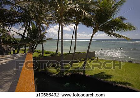 Archivio fotografico vista di oceano da casa for Disegni ponte veranda