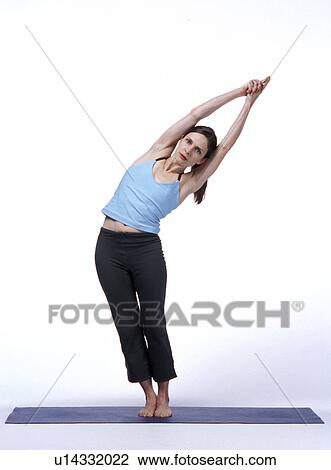 Stock Photo Of Woman Bending Sideways In Yoga Pose With