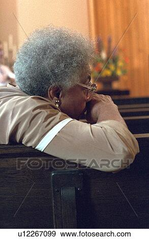 Stock Photograph Of Woman Sitting Thoughtfully In Pew After Church Service U12267099 Search