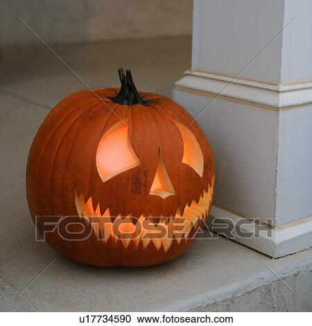 Stock Photography - Carved Halloween pumpkin sitting on doorstep.. Fotosearch - Search Stock Photos & Stock Photography of Carved Halloween pumpkin sitting on doorstep ... pezcame.com