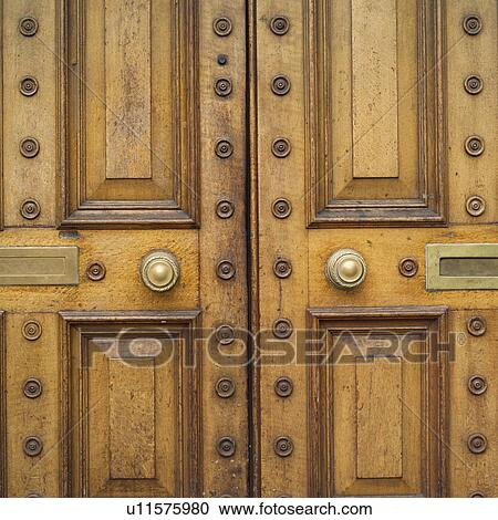 Stock Photography - letter slots and door knob on wooden door. Fotosearch - Search Stock & Stock Photography of letter slots and door knob on wooden door ...