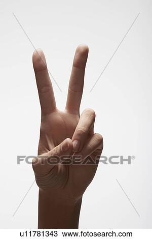 hand making peace sign