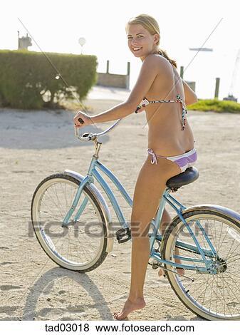 Pictures Of Teenage Girl In A Bikini Riding A Bike On