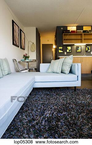 pictures of sofa in loft style apartment lop05308 search stock photos images print. Black Bedroom Furniture Sets. Home Design Ideas