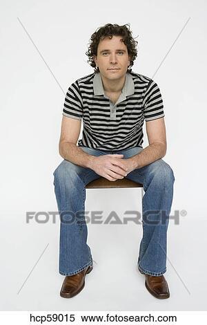 Stock Bild - junger mann, sitzen stuhl hcp59015 - Suche