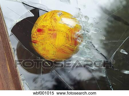 Stock image of close up of broken glass window by soccer for Broken glass mural