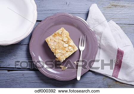 Stock Photo of Yeast cake with almonds and sugar on plate ...