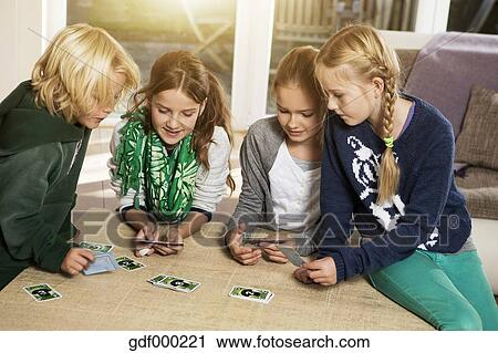 Kids Playing Card Games Clip Art Four children playing card