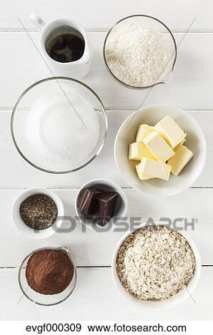 banque de photographies bols de ingr dients pour coco chocolat truffes blanc table. Black Bedroom Furniture Sets. Home Design Ideas
