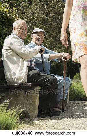 Stock Photography Of Two Old Men Sitting On Park Bench