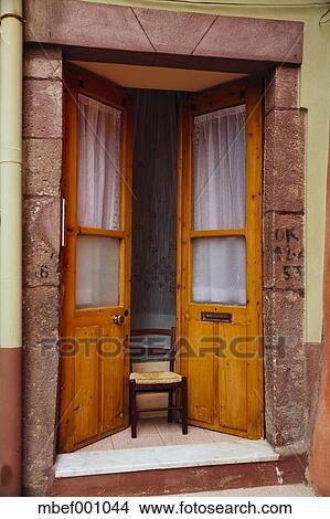 Italy Sarinia Bosa Old door Ajar with chair & Stock Photo of Italy Sarinia Bosa Old door Ajar with chair ...