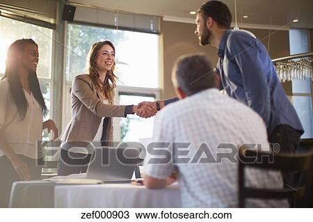 Stock photo of two people greeting each other at a business meeting stock photo two people greeting each other at a business meeting in a restaurant m4hsunfo