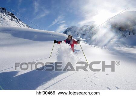 stock images of austria salzburger land woman skiing in mountains hhf00466 search stock. Black Bedroom Furniture Sets. Home Design Ideas