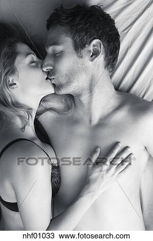 Stock Photo Of Young Couple Kissing In Bed Elevated View Nhf01033