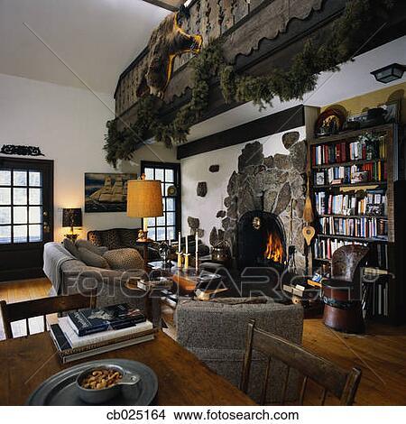 stock foto rustikal wohnzimmer mit a stein. Black Bedroom Furniture Sets. Home Design Ideas