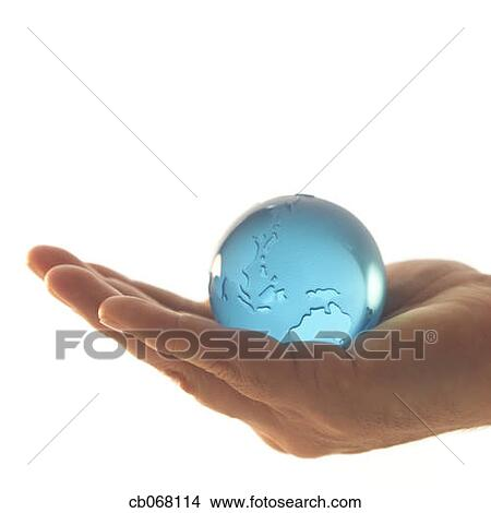 Stock Photo of Outstretched Hand Holding Blue Globe ...