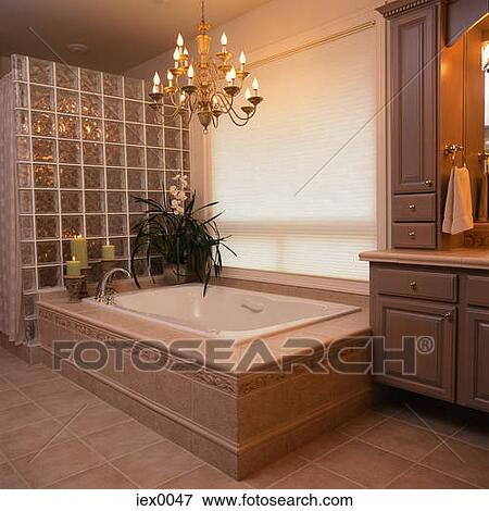 Picture Of Bathtub Under Chandelier In Opulent Bathroom