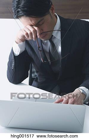 Tired Japanese Businessman Stock Photo Hlng001517 Fotosearch